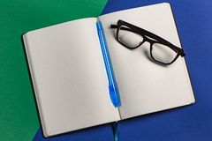 Diary with a pen and glasses royalty free stock images