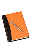 Diary and pen on table isolated Royalty Free Stock Photos