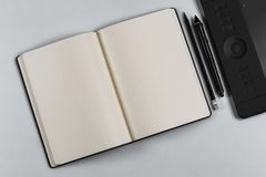 Diary with a pen and tablet royalty free stock photos
