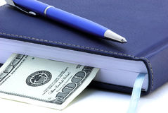 Diary, pen and US dollar isolated Royalty Free Stock Photos