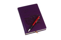 Diary and pen. On a white background purple diary, on which lies a red pen to write it Royalty Free Stock Photography