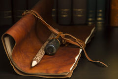 Diary and pencil. A dusty leather diary and wooden pencil Royalty Free Stock Image