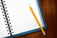 Diary and Pencil. Blank diary and pencil on wooden background Royalty Free Stock Photo