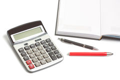 Diary, pencil and calculator. Open diary, red pencil, pen and calculator  on white Stock Image