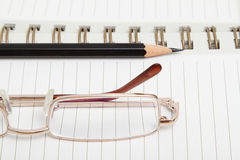 A diary with a pencil and glasses Stock Photo