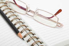Diary, pencil and glasses Royalty Free Stock Photos