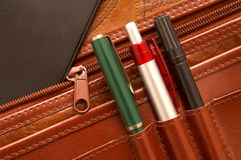 Diary and pencils. In a attache case royalty free stock photography