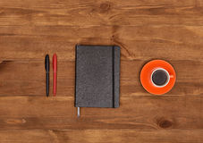 Diary, pens and cup of coffee Stock Image