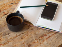 Diary  and phone and  a cup of coffee Royalty Free Stock Images
