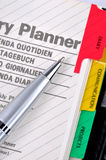 Diary plan and sliver gray pen. Note book including diary plan and a ball pen, shown as daily woking information Stock Image