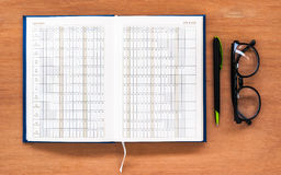Diary planner book open calendar page with glasses and pen on th Stock Photo