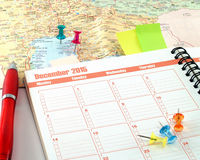 Diary planner and colorful pushpins on map Royalty Free Stock Image