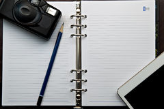 Diary and  retro camera  with Digital Tablet PC Stock Image
