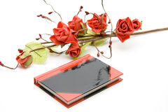 Diary with roses. Small diary with red roses Royalty Free Stock Photography