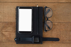 Diary, smart watch, pencil, smartphone and spectacles Royalty Free Stock Image