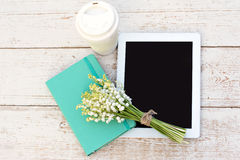 Diary, a tablet computerand  lilies of valley Stock Photos