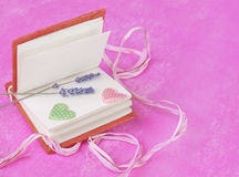 Diary with valentines on a pink background Stock Images