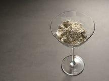 Diatomaceous jord i coctailexponeringsglas Fotografering för Bildbyråer