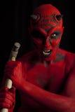 Diavolo rosso che attaca con un martello, Fotografia Stock Libera da Diritti