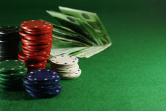 Dibs and money on the casino table Royalty Free Stock Images