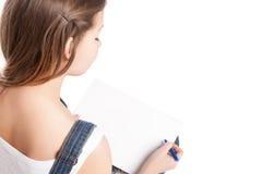 Dibujo de la mujer joven en su cuaderno de notas Visión posterior Imagenes de archivo