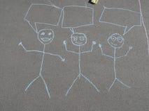 Dibujo de la tiza de los niños en el asfalto Fotografía de archivo libre de regalías