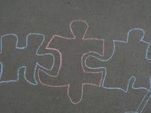 Dibujo de la tiza de los niños en el asfalto Imagen de archivo libre de regalías