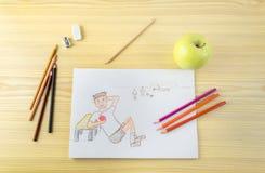 Dibujo de un niño que come la manzana Fotografía de archivo libre de regalías
