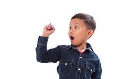 Dibujo del niño pequeño algo en la pantalla Imagen de archivo libre de regalías