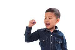Dibujo del niño pequeño algo en la pantalla Fotos de archivo libres de regalías