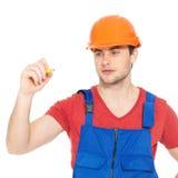 Dibujo del trabajador algo en la pantalla Imagenes de archivo