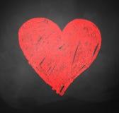 Dibujo marcado con tiza del corazón Fotografía de archivo