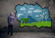 Dibujo urbano joven del pintor Fotografía de archivo