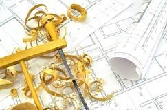Dibujos de ingeniería y herramientas del edificio Imágenes de archivo libres de regalías