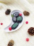 Dibujos de la Navidad en piedras Imagen de archivo libre de regalías