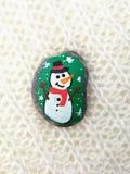 Dibujos de la Navidad en piedras Fotos de archivo
