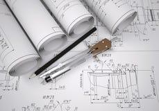 Dibujos y herramientas de ingeniería de las volutas Fotografía de archivo libre de regalías