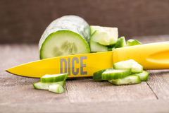Dicced fresh cucumber. Fresh cucumber, dicced with a knife on wooden background cucumber fresh, green vegetable and  healthy food and ingredient, cucumber is raw Royalty Free Stock Image