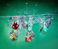 Dice в воду стоковые фото