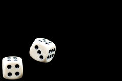 Dice. Playing dice being thrown isolated on black with clipping path included Royalty Free Stock Photos