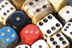 Dice. Collection of different sizes and colours of dice Stock Photos
