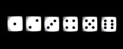 Dice. Six dice on a black background Stock Photography