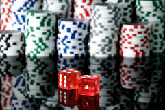 Dice. Red dice and chips background Royalty Free Stock Images