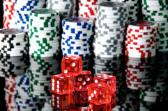Dice. Red dice and chips background Royalty Free Stock Photos