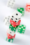 Dice. Red, green and white dice, number one on top Royalty Free Stock Images