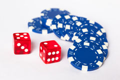 Dice. 2 red dice and blue betting chips royalty free stock photography