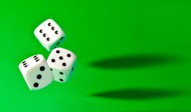 Dice. Falling dice on green background Royalty Free Stock Photo