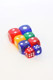 Dice. Collection of different sizes and colours of dice Stock Images