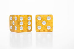 Dice. Clear yellow gold dice on a neutral background Royalty Free Stock Photos