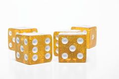 Dice. Clear yellow gold dice on a neutral background Stock Image